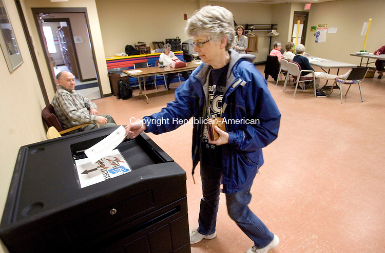 PLYMOUTH CT. 29 April 2014-042917SV02-Betsy Goodwin of Plymouth casts her ballot during a budget referendum at Town Hall in Plymouth Tuesday.<br /> Steven Valenti Republican-American