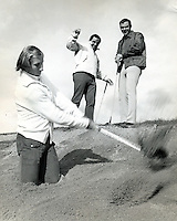 Raider Fred Biletnikoff finds himself buried in a sand trap while Oakland A's third baseman Sal Bando and Raider QB Daryle Lamonica look on. During Lamonica Classic Golf tournament. (1970's photo by Ron Riesterer)