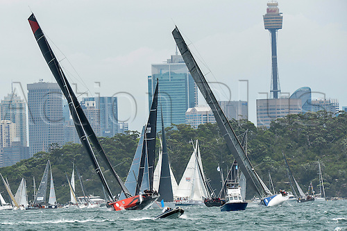 26.12.2015 Sydney, Australia. Rolex Sydney to Hobart Yacht race 2015. Comanche owned by Jim Clark & Kristy Hinze Clark from SA skippered by skipper Ken Read type 100 Supermaxi during the start of the 629 nautical mile race from Sydney to Hobart on Sydney Harbour.