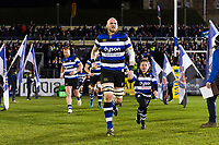 Matt Garvey of Bath Rugby, mascot in hand, leads his team out onto the field. Aviva Premiership match, between Bath Rugby and Northampton Saints on February 9, 2018 at the Recreation Ground in Bath, England. Photo by: Patrick Khachfe / Onside Images