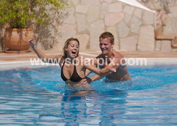 **EXCLUSIVE  PICTURES FROM SOLARPIX.COM**.*MUST AGREE FEE BEFORE PUBLICATION*.**WORLDWIDE SYNDICATION RIGHTS**.*Condition of publication - Must mention El Oceano Beach Hotel on the Costa del Sol*.Zo Christien, the sexy presenter of ITV quiz show, Make Your Play looked like she was on cloud nine while on holiday with hunky Australian boyfriend, Scott Miller, who is the celebrity vet on ITVs This Morning..The TV couple treated themselves to cocktails by the pool, before retiring to the spa at the El Oceano Beach Hotel on the Costa del Sol, Spain..JOB REF:  4762     AB1        DATE: 18.09.07.**MUST CREDIT SOLARPIX.COM OR DOUBLE FEE WILL BE CHARGED* *UNDER NO CIRCUMSTANCES IS THIS IMAGE TO BE REPRODUCED FOR ANY ONLINE EDITION WITHOUT PRIOR PERMISSION*