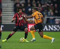 Bournemouth's Nathan Ake (left) battles for possession with Wolverhampton Wanderers' Adama Traore (right) <br /> <br /> Photographer David Horton/CameraSport<br /> <br /> The Premier League - Bournemouth v Wolverhampton Wanderers - Saturday 23rd November 2019 - Vitality Stadium - Bournemouth<br /> <br /> World Copyright © 2019 CameraSport. All rights reserved. 43 Linden Ave. Countesthorpe. Leicester. England. LE8 5PG - Tel: +44 (0) 116 277 4147 - admin@camerasport.com - www.camerasport.com