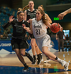 Idaho's        shoots over Portland State's            in a women's Big Sky Tournament semi-final game held at the Reno Events Center on Friday, March 9, 2018 in Reno, Nevada.