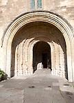 Norman arched door Malmesbury abbey church building, Wiltshire, England, UK