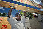 Nixon Manigat (left) and Emma Saint Louis Telusma help construct a school in the Puits Blain neighborhood of Port-au-Prince, Haiti. The construction is supported by the United Methodist Committee on Relief (UMCOR) and Volunteers in Mission, as part of their work in Haiti after the 2010 earthquake..