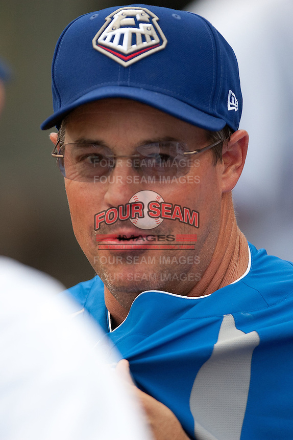 Texas Rangers consultant Greg Maddux in the Round Rock Express dugout during the Pacific Coast League baseball game against the New Orleans Zephyrs on April 30, 2012 at The Dell Diamond in Round Rock, Texas. The Zephyrs defeated the Express 5-3. (Andrew Woolley / Four Seam Images)