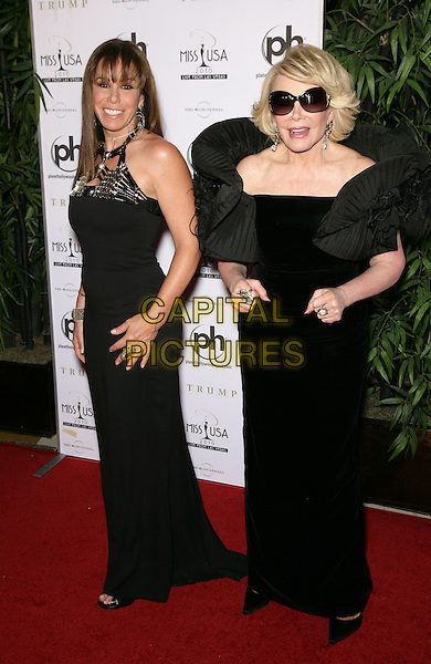 MELISSA RIVERS & JOAN RIVERS .2010 Miss USA Pageant at the Planet Hollywood Resort Hotel and Casino, Las Vegas, Nevada, USA..May 16th, 2010.full length black dress shoulder frills ruffle mother mom mum daughter family maxi sunglasses shades .CAP/ADM/MJT.© MJT/AdMedia/Capital Pictures.