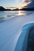 Winter sunrise on frozen lake Urvatnet, Lofoten Islands, Norway