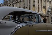 oldtimer, american car in Havana, Cuba, passing capitol and theatre.