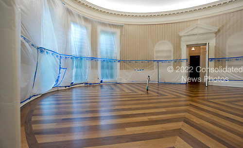 Plastic covers the walls of the Oval Office in the White House West Wing in Washington, DC as it is undergoing renovations while United States President Donald J. Trump is vacationing in Bedminster, New Jersey on Friday, August 11, 2017.  This photo is looking towards the windows where the President's desk usually sits.<br /> Credit: Ron Sachs / CNP