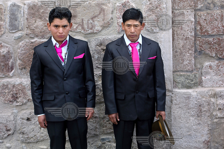 Luis Lema, 24, outside the church on his wedding day with his father, Nicanor Lema.