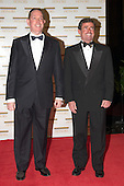 "Michael M. Kaiser and Charles Randall Plummer arrive at the Harry S. Truman Building (Department of State) in Washington, D.C. on December 4, 2004 for a dinner hosted by United States Secretary of State Colin Powell.  At the dinner six performing arts legends will receive the Kennedy Center Honors of 2004.  This is the 27th year that the honors have been bestowed on ""extraordinary individuals whose unique and abundant artistry has contributed significantly to the cultural life of our nation and the world"" said John F. Kennedy Center for the Performing Arts Chairman Stephen A. Schwarzman.  The award recipients are: actor, director, producer, and writer Warren Beatty; husband-and-wife actors, writers and producers Ossie Davis and Ruby Dee; singer and composer Elton John; soprano Joan Sutherland; and composer and conductor John Williams.<br /> Credit: Ron Sachs / CNP"