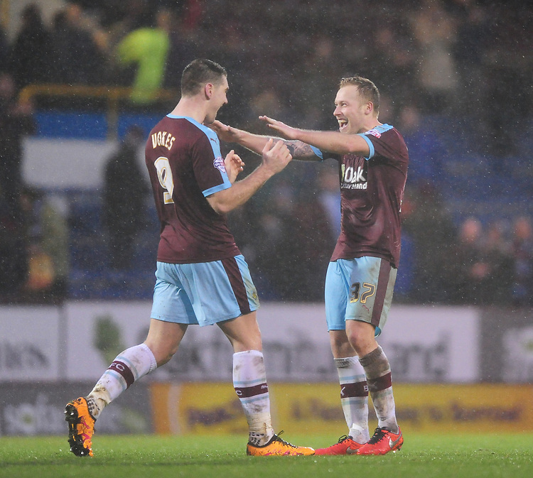 Burnley's Sam Vokes, left, and Burnley's Scott Arfield celebrate the win at the end of the game<br /> <br /> Photographer Chris Vaughan/CameraSport<br /> <br /> Football - The Football League Sky Bet Championship - Burnley v Hull City - Saturday 6th February 2016 - Turf Moor - Burnley <br /> <br /> &copy; CameraSport - 43 Linden Ave. Countesthorpe. Leicester. England. LE8 5PG - Tel: +44 (0) 116 277 4147 - admin@camerasport.com - www.camerasport.com