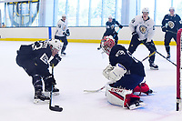 June 29, 2018: Boston Bruins forward Karson Kuhlman (83) takes a shot at goalie Kyle Kyser (85) during a scrimmage at the Boston Bruins development camp held at Warrior Ice Arena in Brighton Mass. Eric Canha/CSM