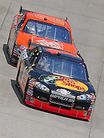 Jun 1, 2008; Dover, DE, USA; NASCAR Sprint Cup Series driver Martin Truex Jr (1) leads Tony Stewart (20) during the Best Buy 400 at the Dover International Speedway. Mandatory Credit: Mark J. Rebilas-US PRESSWIRE