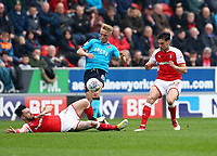 Kyle Dempsey of Fleetwood Town tackled by Richie Towell of Rotherham United during the Sky Bet League 1 match between Rotherham United and Fleetwood Town at the New York Stadium, Rotherham, England on 7 April 2018. Photo by Leila Coker.
