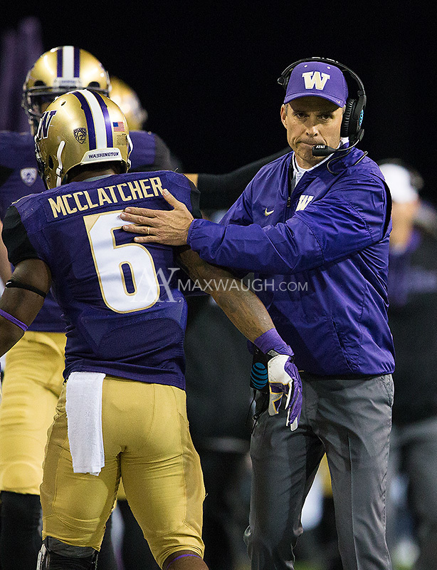 Chris Petersen shows tons of emotion when congratulating Chico McClatcher on his long touchdown.