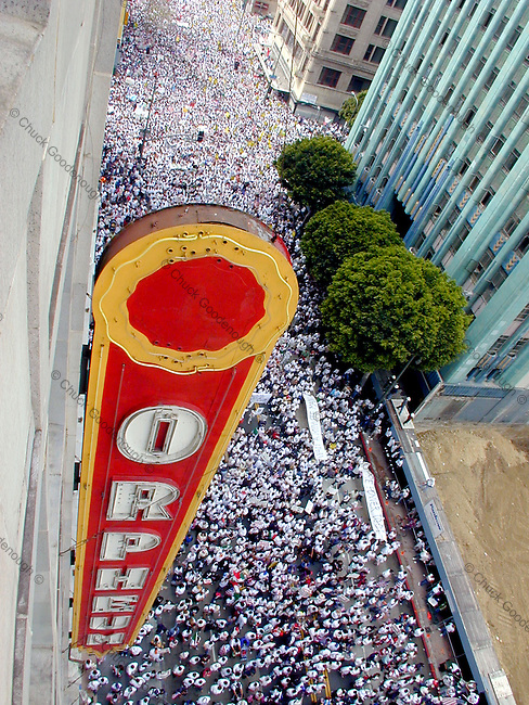 Photo shows the mass of people marching in the immigration rally that took place on Brodayway St. March 25th 2006 in Los Angeles, California against proposition HR4437. This Photo is looking south from the 9th floor of the Orpheum Theater bldg. No property Release. Editorial use only.