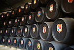 Oak barrels with national symbols of countries exported to from Gonzalez Byass bodega, Jerez de la Frontera, Spain