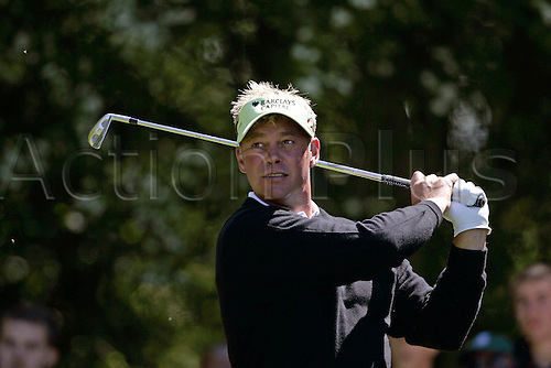 15 May 2005: Northern Irish golfer Darren Clarke looks into the distance after playing an iron from the 2nd tee during the final round of the The Daily Telegraph Dunlop Masters played at the Forest of Arden, Warwickshire. Photo: Neil Tingle/actionplus..050515 golf golfer