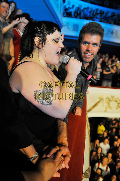 Beth Ditto of Gossip & Perez Hilton performing live in concert, Shepherd's Bush Empire, London, England. 5th July 2012.**Exclusive - special rates apply**.on stage live gig performance music half length black leotard tattoo singing balcony fans crowd audience grey gray check shirt side profile  .CAP/MAR.© Martin Harris/Capital Pictures.