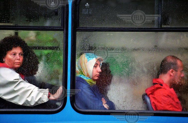 Female passengers on a bus.