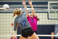 NWA Democrat-Gazette/CHARLIE KAIJO Bentonville West High School Winnie Spurlock (5) blocks during the girl's volleyball game on Thursday, October 12, 2017 at Bentonville West High School in Centerton.