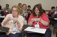OrigamiUSA 2016 Convention at St. John's University, Queens, New York, USA. Creasers in Paul Frasco's Dragon Hatchling class. Donna Walcavage (l), New York and Rachel Avery (r) Wisconsin.