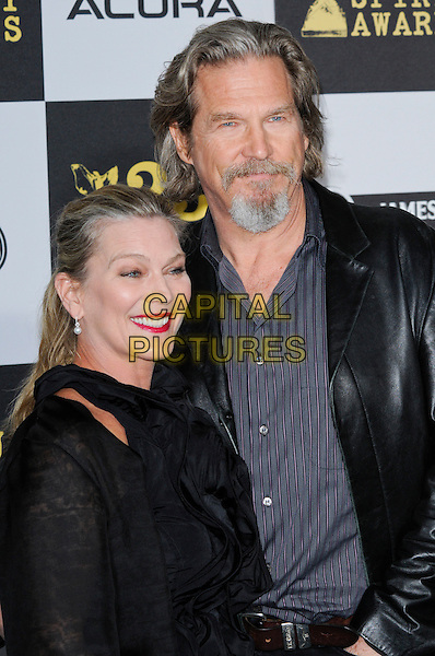 SUSAN & JEFF BRIDGES .The 25th Annual Film Independent Spirit Awards at the LA Live Event Deck in Los Angeles, California, USA..March 5th, 2010  .half length leather jacket married husband wife black blue goatee facial hair .CAP/ROT.©Lee Roth/Capital Pictures