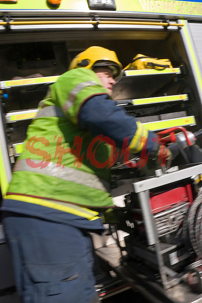 Firefighters attend a  road traffic accident and work to release the trapped driver. This image may only be used to portray the subject in a positive manner..©shoutpictures.com..john@shoutpictures.com