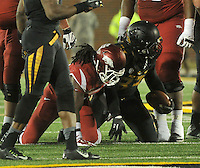NWA Media/Michael Woods --11/28/2014-- w @NWAMICHAELW...University of Arkansas running back Alex Collins gets up after loosing a fumble to Missouri defender Markus Golden in the 4th quarter of Friday afternoons game at Faurot Field in Columbia Missouri.