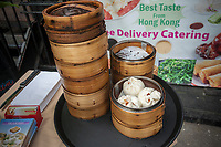 Dim Sum Palace serves steamed dumplings after the unveiling of the new wayfinding kiosks that stand at either end of Restaurant Row in New York, West 46th street between 8th and 9th Avenues, on Tuesday May 16, 2017. At least four years in the making the illuminated kiosks show the names of the many eateries that populate the street. The unveiling is just in time for the Taste of Times Square event taking place on the street on June 5. (© Richard B. Levine)