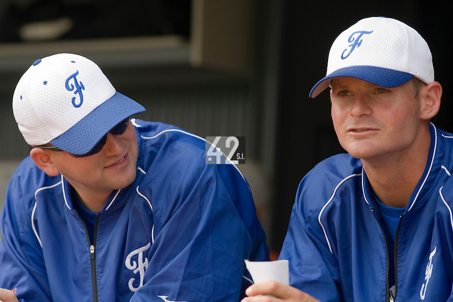 18 August 2007: Coach Joshua Ridgway (left) and Team Manager Jeff Zeilstra (right) are seen in the dugout prior to the China 5-1 victory over France in the Good Luck Beijing International baseball tournament (olympic test event) at the Wukesong Baseball Field in Beijing, China.