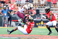 College Park, MD - SEPT 22, 2018: Minnesota Golden Gophers running back Mohamed Ibrahim (24) jumps to avoid the tackle of Maryland Terrapins defensive back Antwaine Richardson (20) during game between Maryland and Minnesota at Capital One Field at Maryland Stadium in College Park, MD. The Terrapins defeated the Golden Bears 42-13 to move to 3-1 on the season. (Photo by Phil Peters/Media Images International)