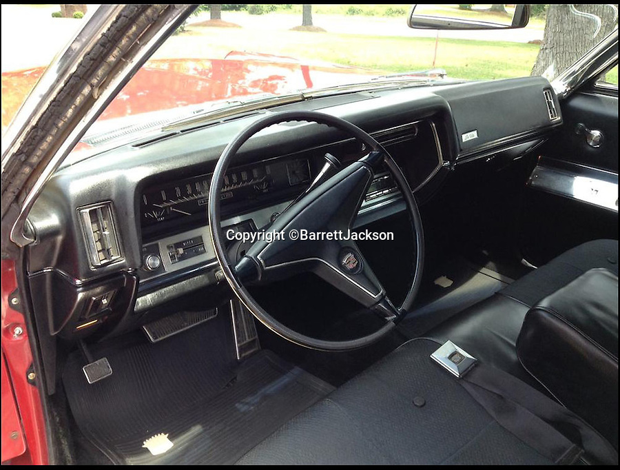BNPS.co.uk (01202 558833)<br /> Pic: BarrettJAckson/BNPS<br /> <br /> ***Please Use Ful Byline***<br /> <br /> The interior of Elvis Preserly's Cadillac. <br /> <br /> A plush red Cadillac which Elvis Presley bought to drive on his honeymoon with Priscilla has sold for a whopping 55,000 pounds.<br /> <br /> The King snapped up the bright red motor after marrying wife Priscilla in Las Vegas on May 1, 1967 and the pair were often seen driving it around Memphis, home to Elvis' legendary Graceland mansion.<br /> <br /> The couple, who were married for six years, also used to drive the car to Elvis' 163-acre Circle G ranch in Mississippi where they spent some of their honeymoon.<br /> <br /> The 1967 Cadillac Coupe de Ville was bought by a private collector at a sale in Las Vegas held by classic car auctioneers Barrett Jackson.