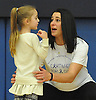 Charlotte Kindelmann, 4, chats with her mother, Cold Spring Harbor gymnastics head coach Teri Kindelmann, during the eight-team Cartwheel for a Cure gymnastics meet at Cold Spring Harbor High School on Monday, Jan. 16, 2017. Charlotte and her six-year-old sister Matison were born with cystic fibrosis. The meet raised funds toward developing a cure.