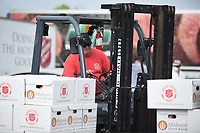Brian Drummond, with the Salvation Army of Northwest Arkansas, drives a forklift to arrange pallets of food Tuesday, July 28, 2020, at Arvest Ballpark in Springdale. The Salvation Army of Northwest Arkansas in partnership with the Church of Jesus Christ of Latter-Day Saints distributed 800 boxes of food to provide relief during the covid-19 pandemic. Both organizations have worked together nationally and saw this as an opportunity to work together locally. Donations were also contributed by The Pack Shack and Tyson Meals that Matter. The use of Arvest Ballpark was made possible by the Northwest Arkansas Naturals. For more information about the group visit nwaadoptacop.com. Check out nwaonline.com/200729Daily/ and nwadg.com/photos for a photo gallery.<br /> (NWA Democrat-Gazette/David Gottschalk)