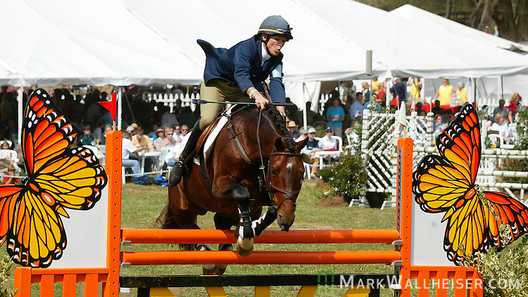 Jennie Jarnstrom, atop Chant de Paix, hangs on as she comes over a jump in the CIC two star division of the Red Hills Horse Trials in Tallahassee, Florida March 14, 2004. (Mark Wallheiser/TallahasseeStock.com)