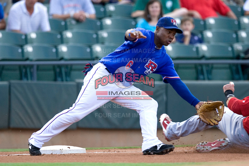 Round Rock Express third baseman Esteban German #6 plays defense during a game against the Memphis Redbirds at the Dell Diamond on July 10, 2011in Round Rock, Texas.  Memphis defeated Round Rock 10-9.  (Andrew Woolley / Four Seam Images)