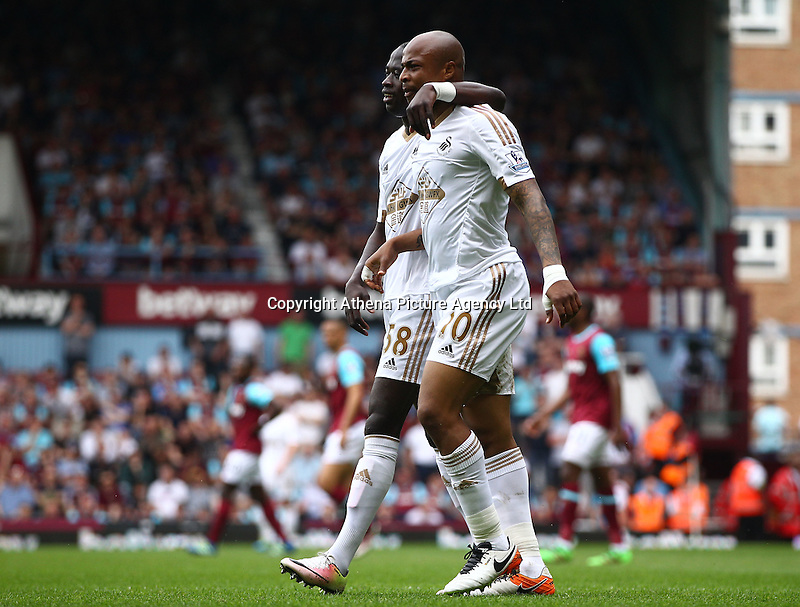 Andre Ayew of Swansea celebrates scoring his sides second goal with team-mate  Modou Barrow of Swansea   during the Barclays Premier League match between West Ham United and Swansea City  played at Boleyn Ground , London on 7th May 2016
