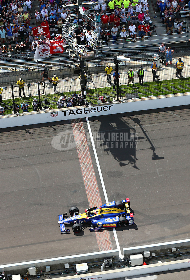 May 29, 2016; Indianapolis, IN, USA; IndyCar Series driver Alexander Rossi takes the checkered flag to win the 100th running of the Indianapolis 500 at Indianapolis Motor Speedway. Mandatory Credit: Mark J. Rebilas-USA TODAY Sports