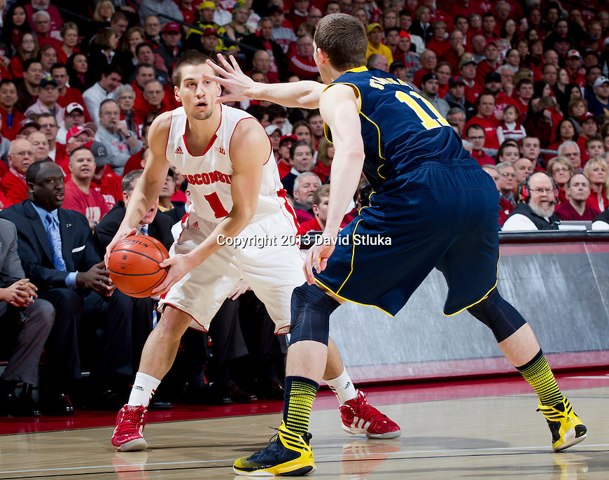 Wisconsin Badgers guard Ben Brust (1) handles the ball during a Big Ten Conference NCAA college basketball game against the Michigan Wolverines Saturday, February 9, 2013, in Madison, Wis. The Badgers won 65-62 (OT) (Photo by David Stluka)