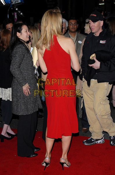 "FELICITY HUFFMAN .attends The Touchstone Pictures' World Premiere of ""Wild Hogs"" held at The El Capitan Theatre in Hollywood, California, USA, February 27 2007. .full length red dress rear back behind.CAP/DVS.©Debbie VanStory/Capital Pictures"