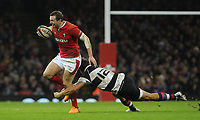 Wales Hadleigh Parkes is tackled by Barbarians Andre Esterhuizen<br /> <br /> Photographer Ian Cook/CameraSport<br /> <br /> 2019 Autumn Internationals - Wales v Barbarians - Saturday 30th November 2019 - Principality Stadium - Cardifff<br /> <br /> World Copyright © 2019 CameraSport. All rights reserved. 43 Linden Ave. Countesthorpe. Leicester. England. LE8 5PG - Tel: +44 (0) 116 277 4147 - admin@camerasport.com - www.camerasport.com