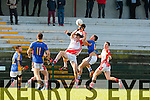 Team mates Aodhn Ó Conchuir  and Padraig Mac an tSíthigh PS Corcha Dhuibhne collide ahead of Tralee CBS Ivan Parker during the quarter final of the Corn Uí Mhuirí in Killarney on Wednesday