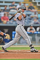 Kannapolis Intimidators first baseman Danny Hayes #32 swings at a pitch during a game against the Asheville Tourists at McCormick Field on June 5, 2014 in Asheville, North Carolina. The Intimidators defeated the Tourists 5-3. (Tony Farlow/Four Seam Images)