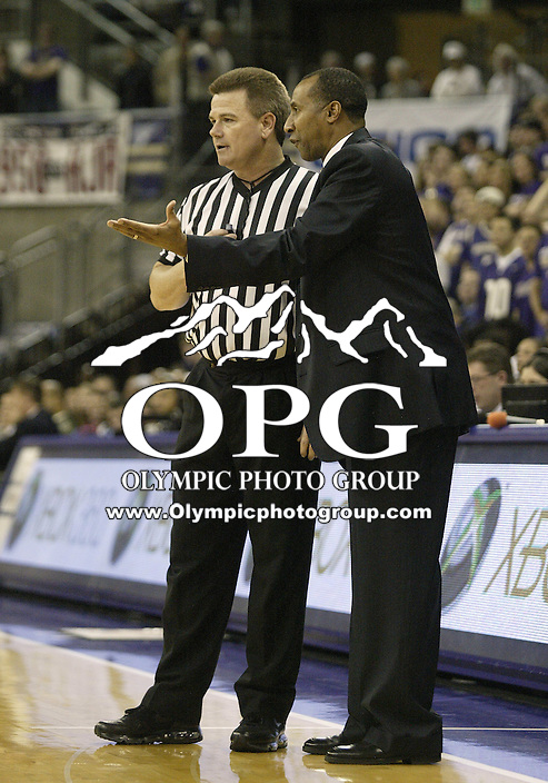 14 January 2010:  Stanford head coach Johnny Dawkins gives Official Deron White an ear full during the game against Washington. Washington won 94-61 over Stanford at the Bank of America Arena in Seattle, WA.