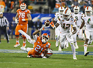 Charlotte, NC - December 2, 2017: Miami Hurricanes defensive back Malek Young (12) tries to recover a fumble during the ACC championship game between Miami and Clemson at Bank of America Stadium in Charlotte, NC.  (Photo by Elliott Brown/Media Images International) Clemson defeated Miami 38-3 for their third consecutive championship title.