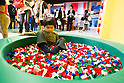 June 14, 2012, Tokyo, Japan - A young boy plays inside a pool of Lego bricks during a press preview event at the LEGOLAND Discovery Center Tokyo. The LEGOLAND Discovery Center contains over 3 million LEGO bricks in-house, a 4D movie theater, iconic city land marks of Tokyo all made of LEGO, and a interactive laser ride. The discovery center will open to the general public on June 15, 2012. (Photo by Christopher Jue/AFLO)