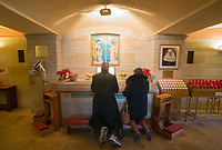 People pray at the National Shrine of St. Katharine Drexel Thursday, December 28, 2017 in Bensalem, Pennsylvania. Drexel was an American heiress who dedicating herself to work among the American Indians and African-Americans in the western and southwestern United States. She was canonized a saint by the Roman Catholic Church in 2000. (Photo by William Thomas Cain/Cain Images)